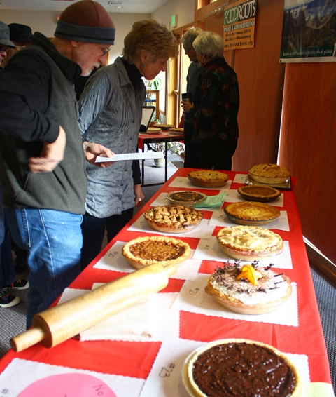 Bidders looking at the pies to bid on at Pie day